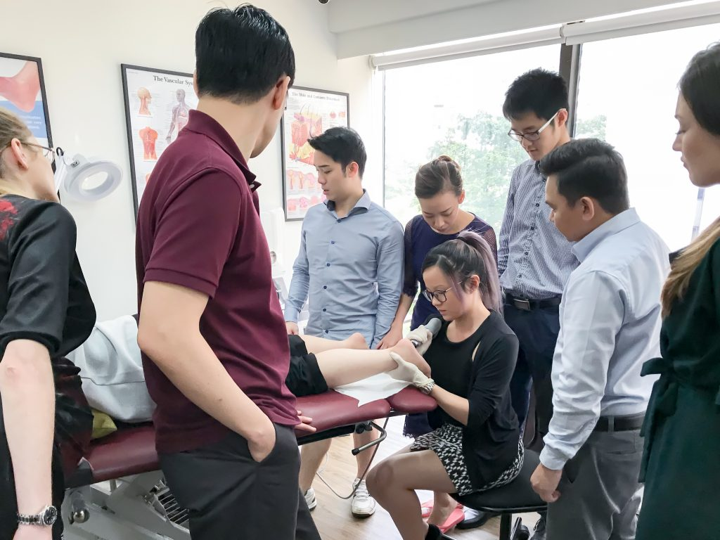 Intern Practising with Shockwave | East Coast Podiatry