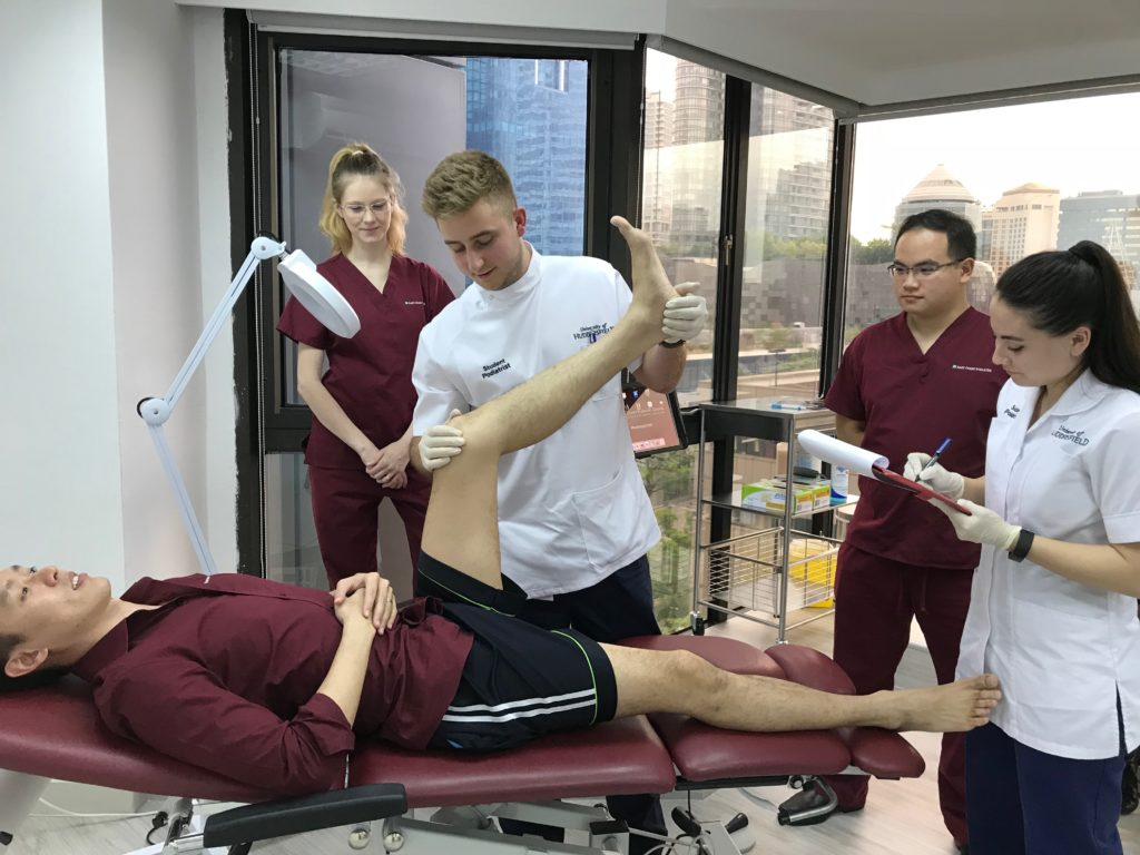Interns assessing patient's foot | East Coast Podiatry