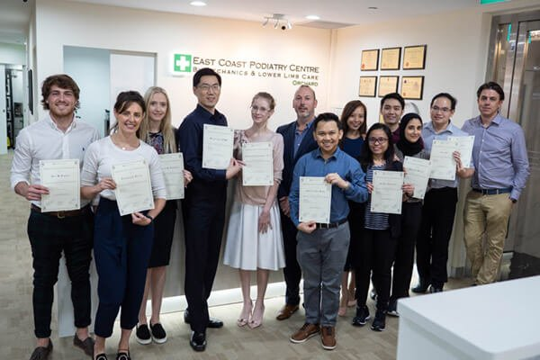 East Coast Podiatry | Podiatrist getting certificate for completing Workshop with Mark Ould