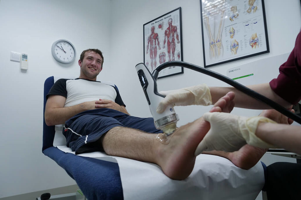 Jamie taking shockwave therapy treatment