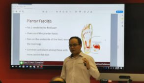 Podiatrist Ben giving a presentation on Plantar Fasciitis